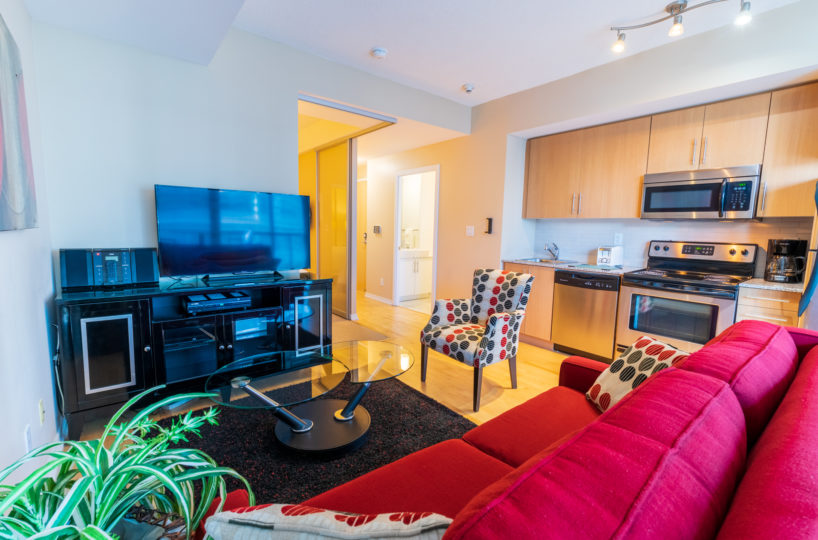 Suite for Rent at Maple Leaf Square Downtown Toronto. Living Room Kitchen TV