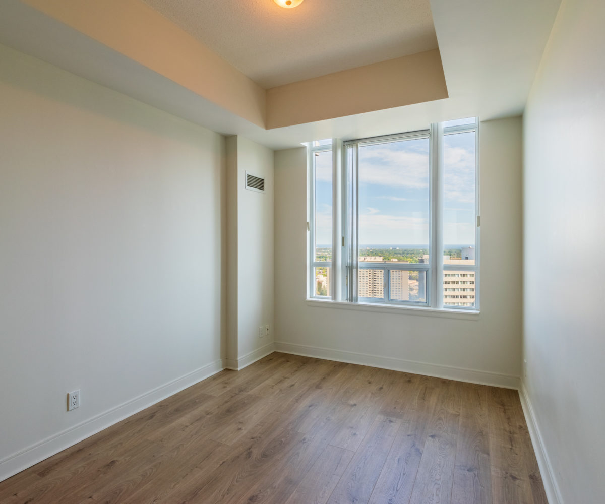 Mississauga Apartment for Rent at 90 Absolute Master Bedroom White Walls Window with view to the city