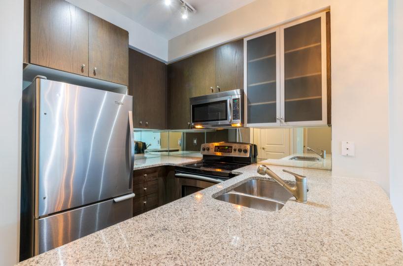 Rental Condo Kitchen, Stainless Steel Appliances, Fridge, microwave, Sink, Dish washer