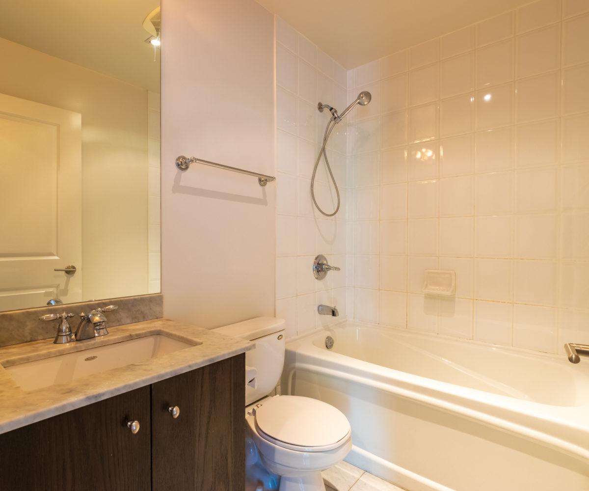 Rental Condo washroom toilet and mirror