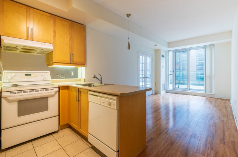 Suite for Rent at Elev'n Residences. Toronto, Ontario. Kitchen Living Room Terrace