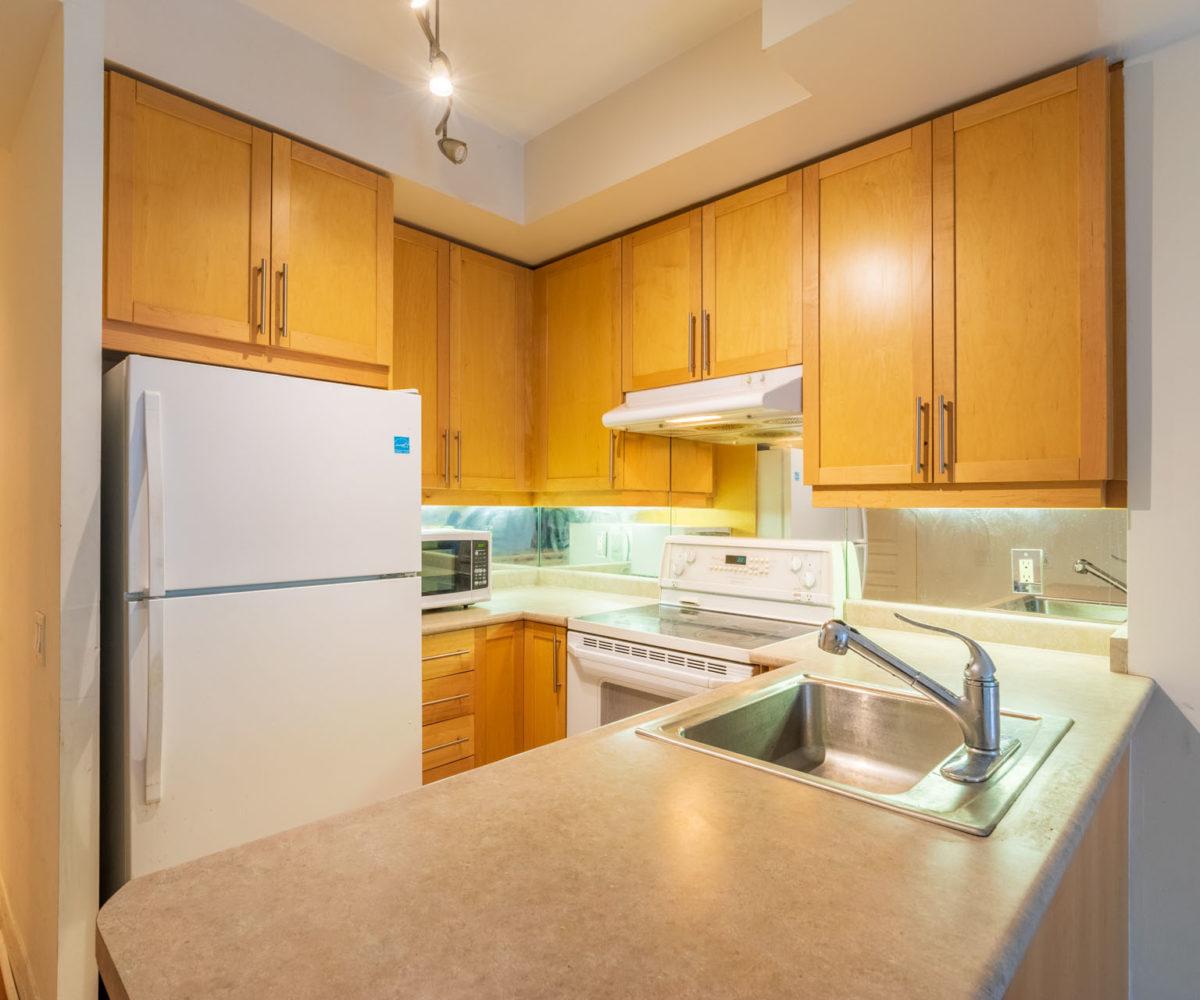 Condo Rental at Elev'n Residences. Toronto, Ontario. Kitchen Side