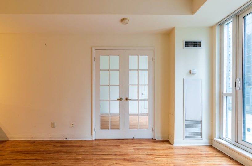 Apartment for Rent at Elev'n Residences. Toronto, Ontario. Living Room Master Door