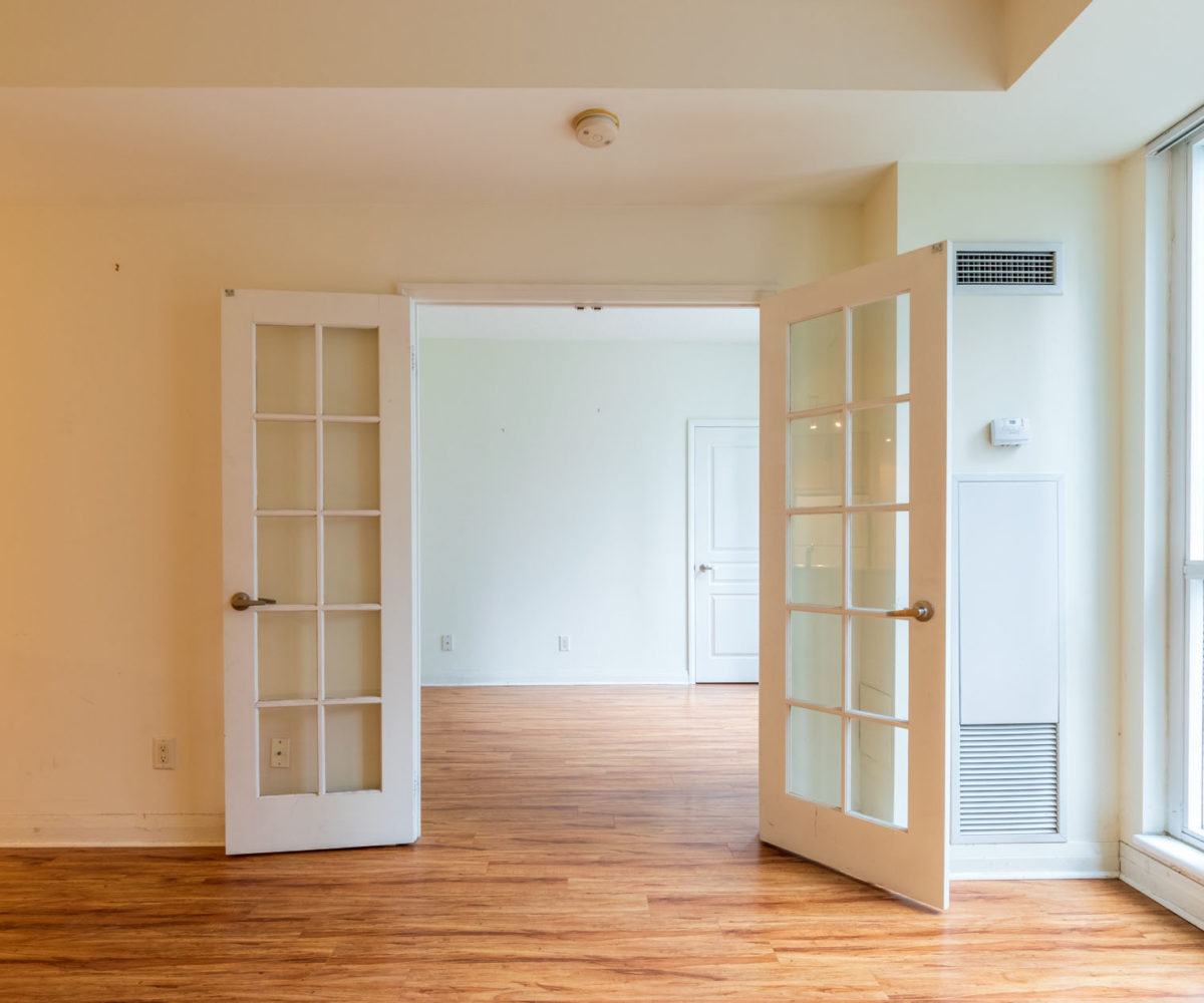 Suite for Rent at Elev'n Residences. Toronto, Ontario. Living Room Master Door